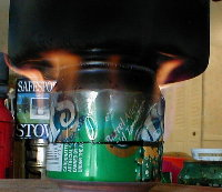 stove lit with pot on top